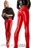 Preview: A woman with a skin fit latex jean in shiny red and she wears red high heels and a cape in gray