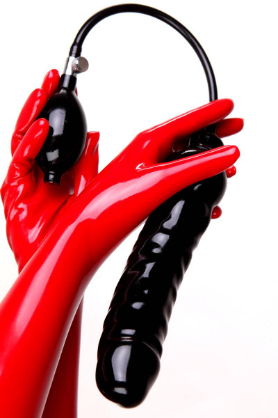 A big black latex dildo with pump and tube which can be inflated even bigger.