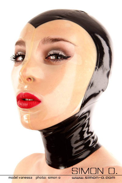 A woman wears a black latex hood with a transparent face panel