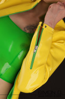 Preview: A woman in a yellow latex jacket with pockets and green zipper