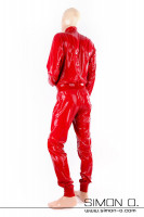 Preview: A man wearing a comfortably loose fit homewear suit in shiny red latex