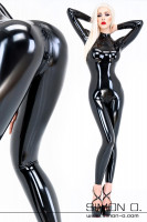 Preview: A woman wears a shiny skintight black latex catsuit with skintight fit