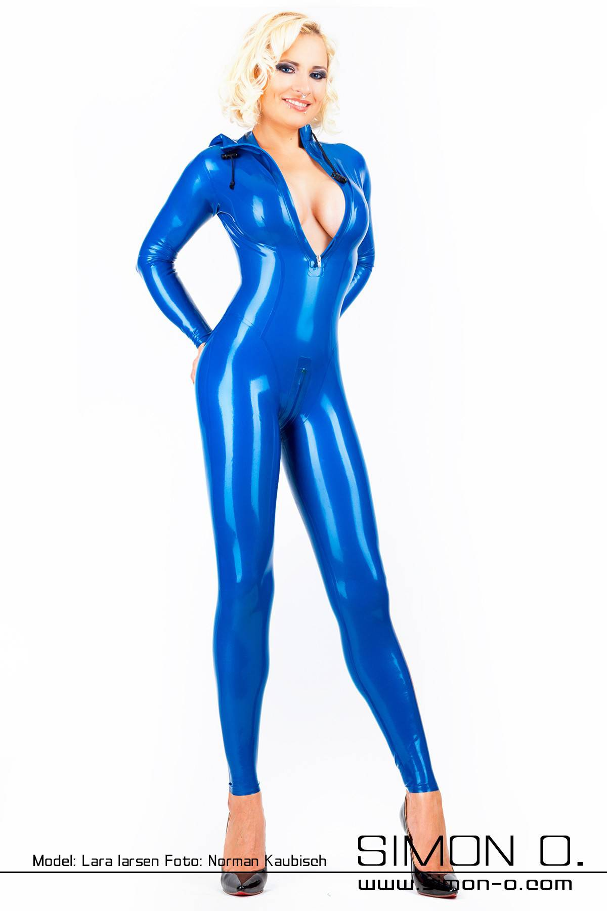 Blonde woman in a blue latex catsuit with hood The suit is skin tight and wet shiny
