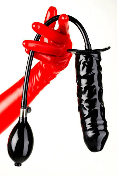 Latex dildo in black with pump held by one hand dressed with red latex gloves