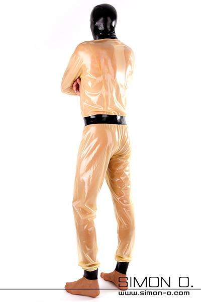 A man in a loose fit transparent latex suit with mask and gloves