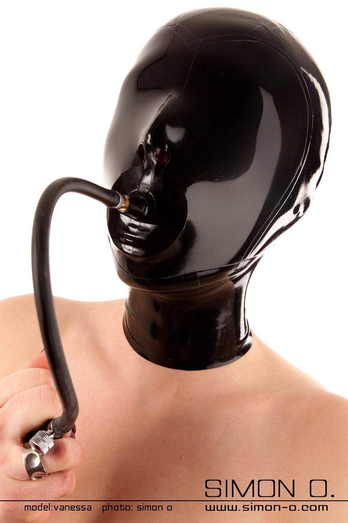 Slaves latex hood in black with closed eyes and inflatable gag