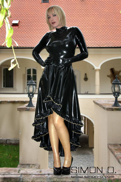 Elaborately crafted long latex circle skirt At the hem this exquisite latex skirt are several meters of gorgeous ruffles which are individually laid and glued …