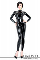 Preview: A dark-haired woman with a wrinkle-free sitting shiny latex catsuit in black - with a zipper in the crotch