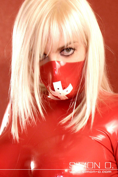 Latex surgical mask made of thick latex with latex bands and perforation for breathing. Perfect for medical roleplay. Model shown: Color 1: Red Contrast: White