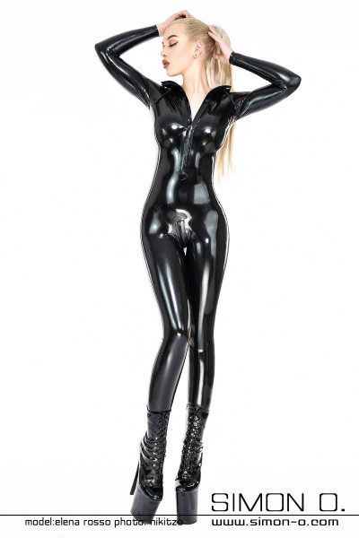 A blonde model with a shiny skintight hooded latex catsuit in black