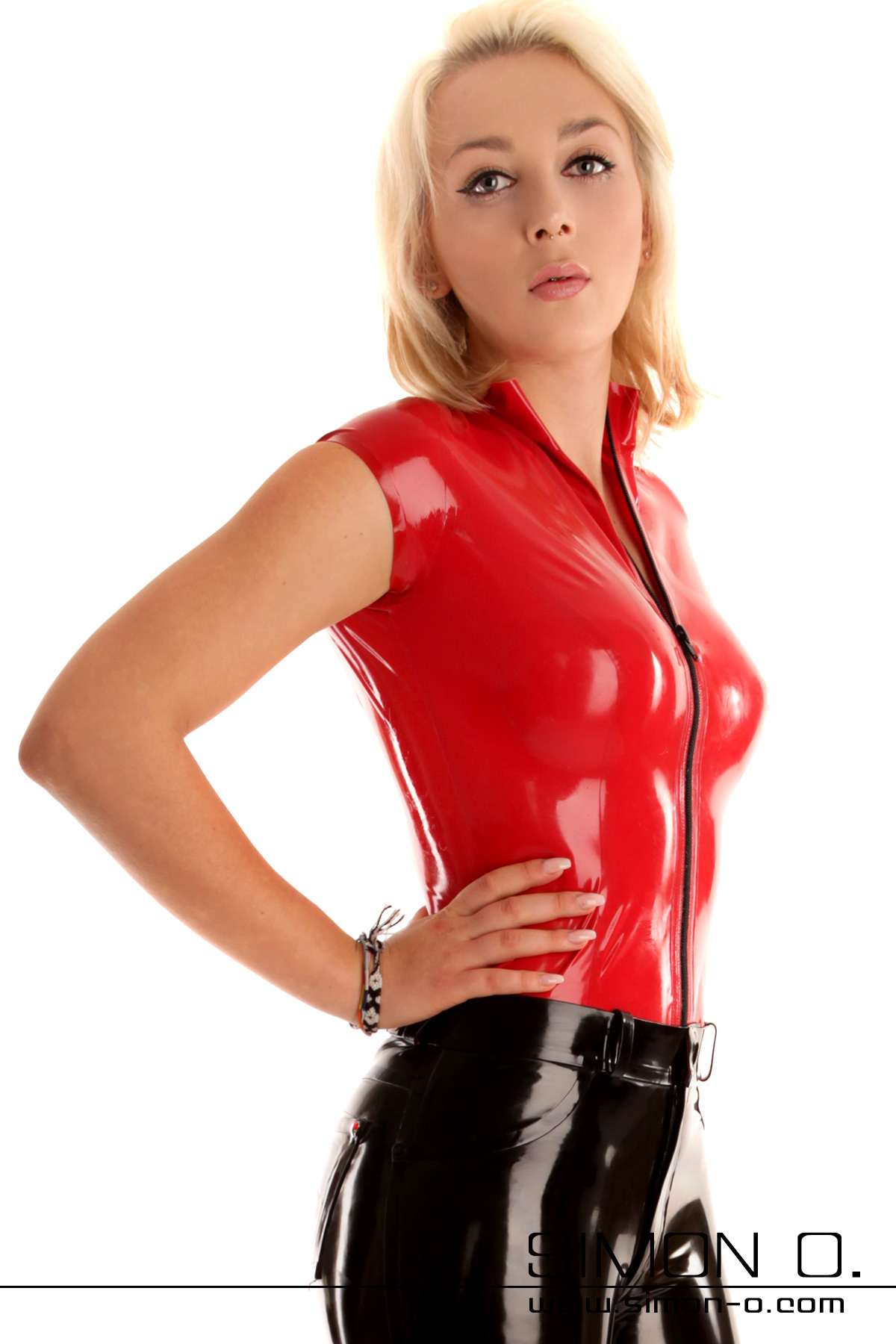 Ladies short sleeve latex shirt with separable zip This sexy skin-tight latex shirt is available in over 40 colours. In addition to your chosen latex shirt …