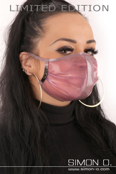 A dark-haired woman is wearing a latex face mask in Violet Transparent