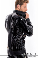 Preview: A man wears a latex jacket in black with stand-up collar and pockets seen from behind.