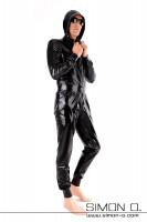 Vorschau: Ganzanzug mit Taschen und Kapuze in Schwarz locker geschnitten tailliert mit Manschetten bei Armen und Beinen