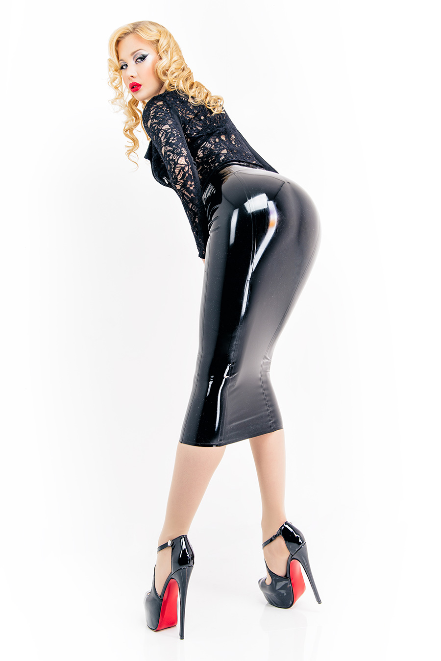 Women with a long latex skirt in black in combination with High Heels and textile clothing