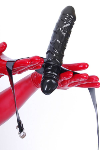 A dildo and a gag with the shape of a large and a small penis in one in black with fastening straps