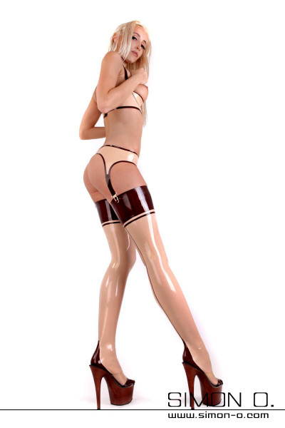 Latex stockings with seam and high heel Not only in foot fetishists will these latex stockings get the blood pumping! These latex stockings with back seam and …