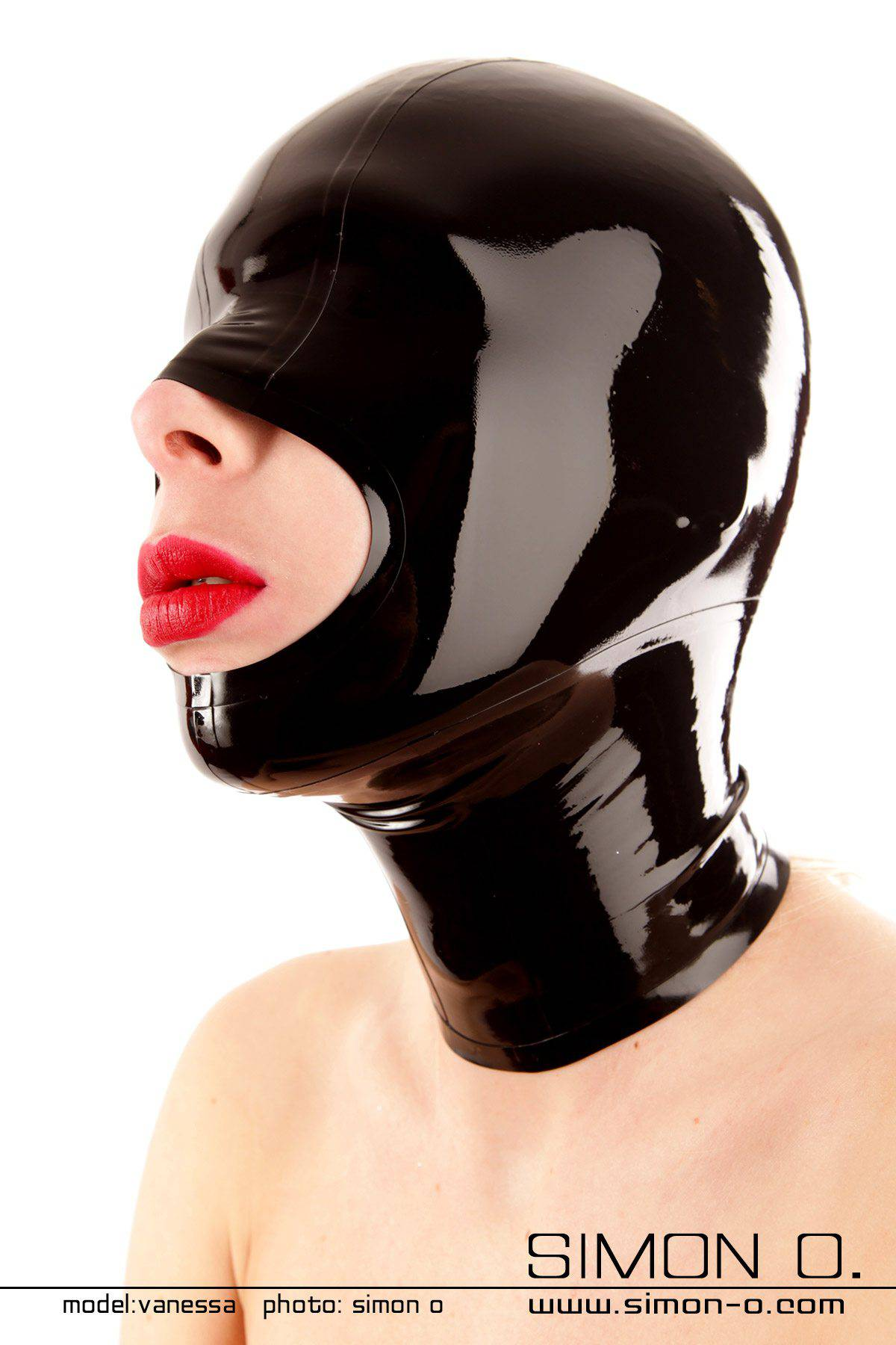 A black shiny latex hood with closed eyes and large opening for the mouth.