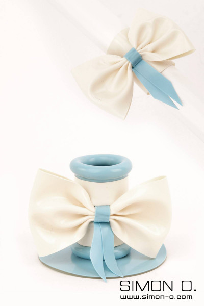 Decorative bow addition for our tubes, which fit on all tubes and can be changed Shown Tube addition: Colour 1: White (bow) Trim colour 1: Light Blue (loop)
