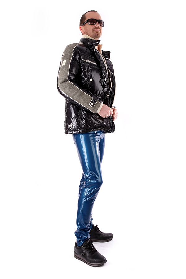 A blue shiny latex jeans for men combined with a jacket and sneakers