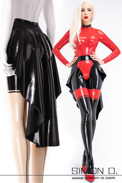 A black latex train worn in combination with a catsuit