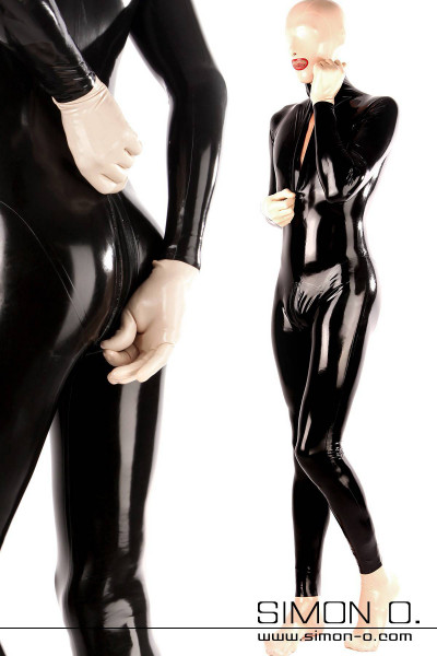 A man with a latex hood wears a black skintight latex suit with a crotch zipper and a front entry zipper.