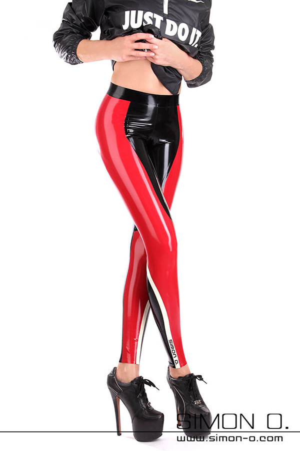 A woman is wearing tight fitness latex pants in black combined with red and white