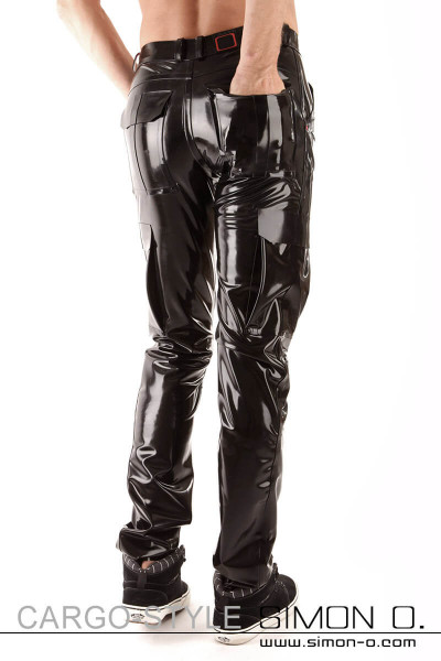 A shiny cargo style latex pant with pockets seen from behind on the waistband are belt loops and a Simon O. logo.