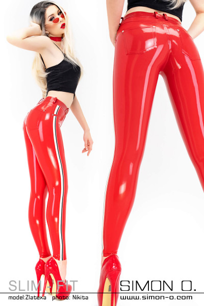 A blonde woman wears a tight red latex jean with stripes on the side