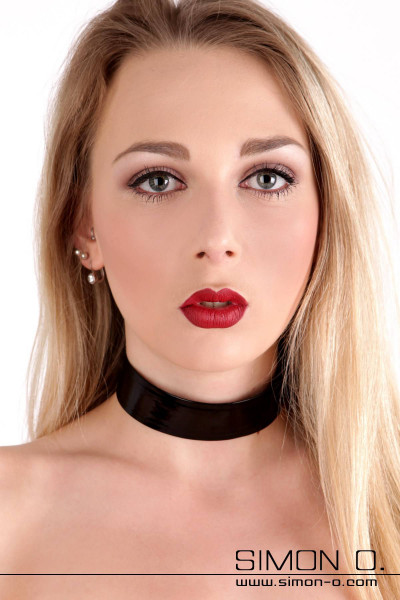 A woman wears a shiny latex collar in black