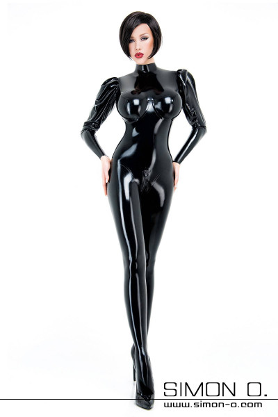 A woman wears a tight shiny dominatrix latex catsuit in black with puffy sleeves