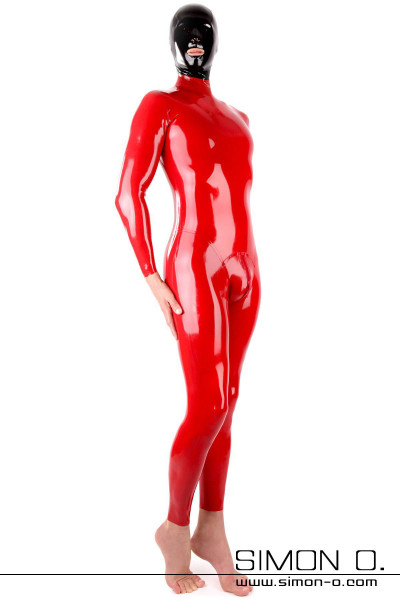 A man wears a tight shiny red latex suit with crotch zipper and a black latex hood seen from the front