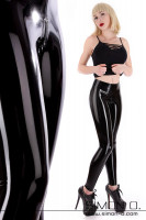Preview: A blonde woman with tight fitting shiny black latex leggings. She wears a top and high heels combined with it.