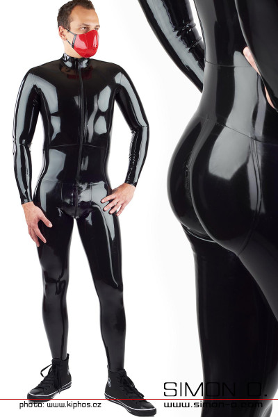 A man wears a black tight latex suit with an integrated bodice belt