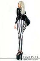Preview: Woman with extreme high heels is dressed with a black latex blouse and a striped pants