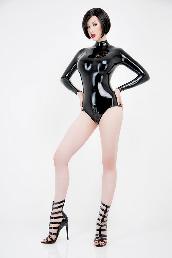 Black shiny latex leotard with skin tight fit worn by a woman with black hair