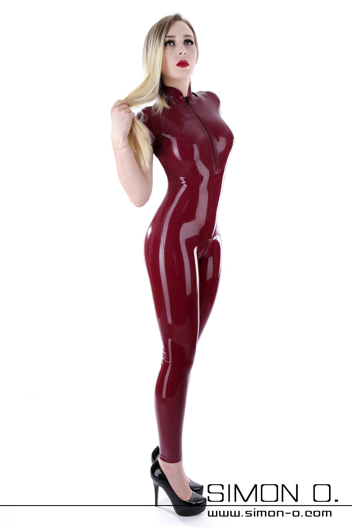 Short sleeve latex catsuit skin-tight with décolleté and crotch zipper.