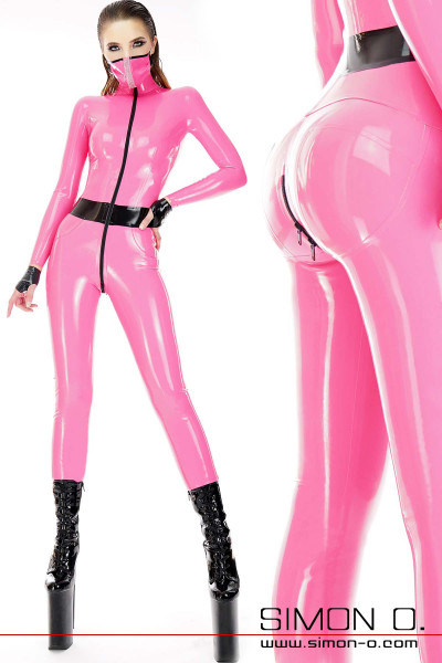 A woman wears a shiny skin tight latex catsuit in pink with bubble butt effect