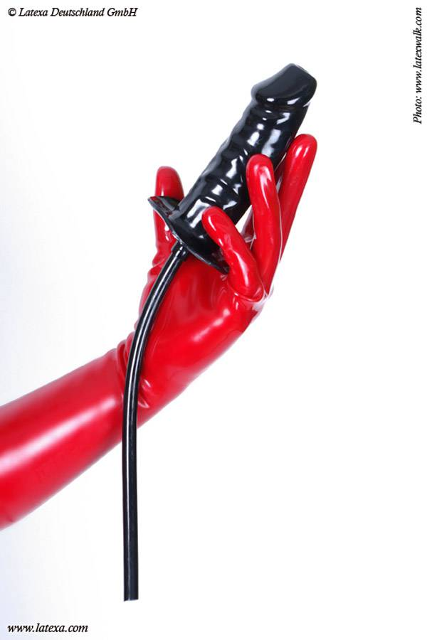 Enema dildo in black with the shape of a limb a tube leads into the inside of the dildo