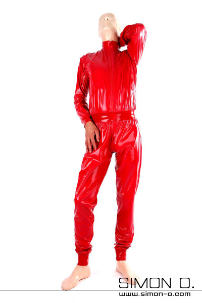 A man with a latex mask wears a loose latex catsuit in shining red