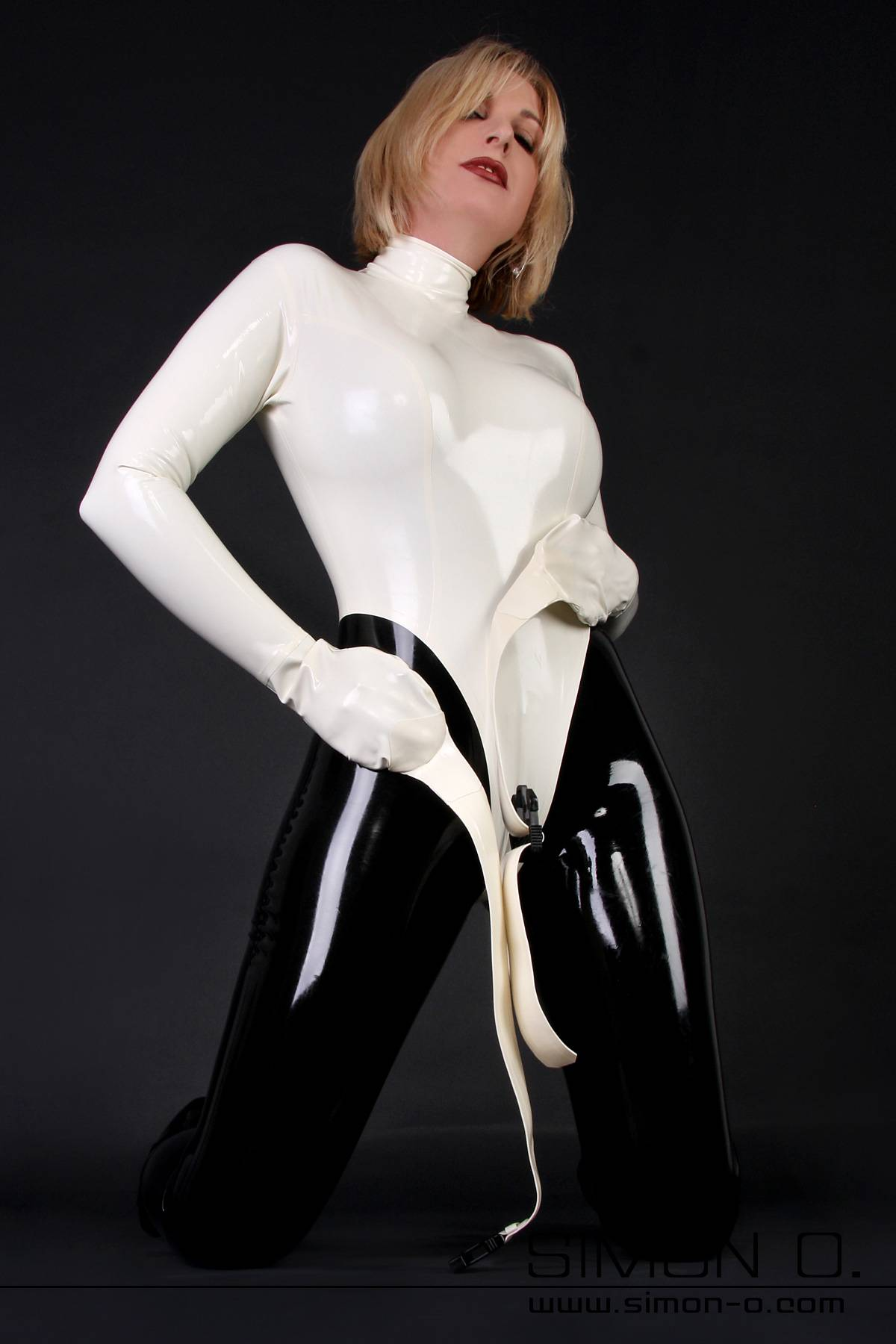 Highly erotic straightjacket made of strong latex. This latex body in straightjacket form features attached mittens with straps for the ultimate in security …