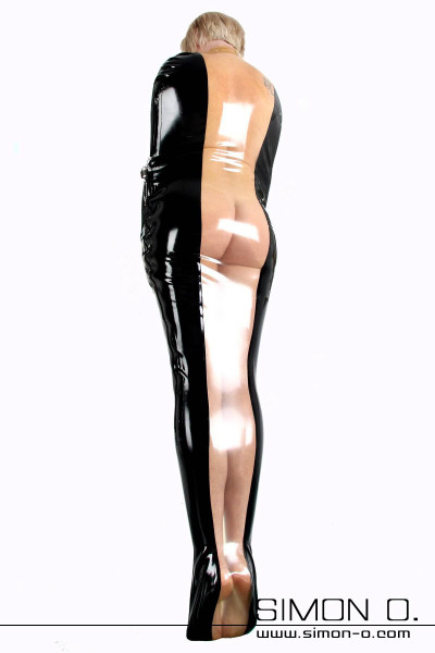 A woman in a latex bondage bag in black with transparent insert. At the side the bondage sack can be closed.