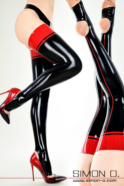 Women's legs in black shiny latex stockings with red garter and red seam at the back