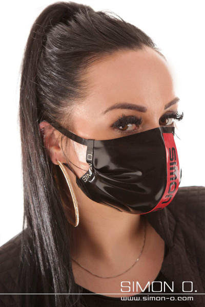 Shiny mouth and nose guard made of latex in black with red strands and Simon O. Logo in black