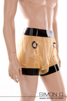 Preview: Latex pants for golden shower in transparent with black