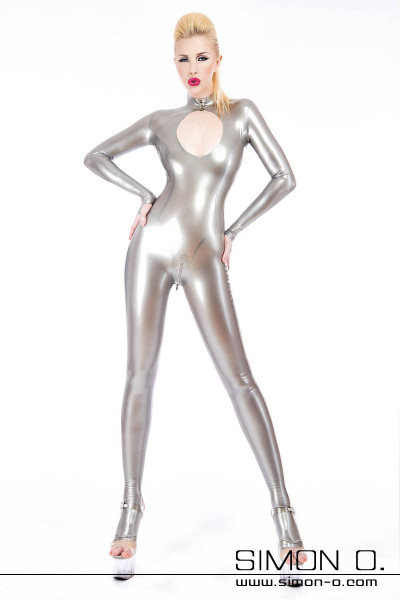 A blonde standing woman in a shiny silver latex catsuit with sexy cleavage