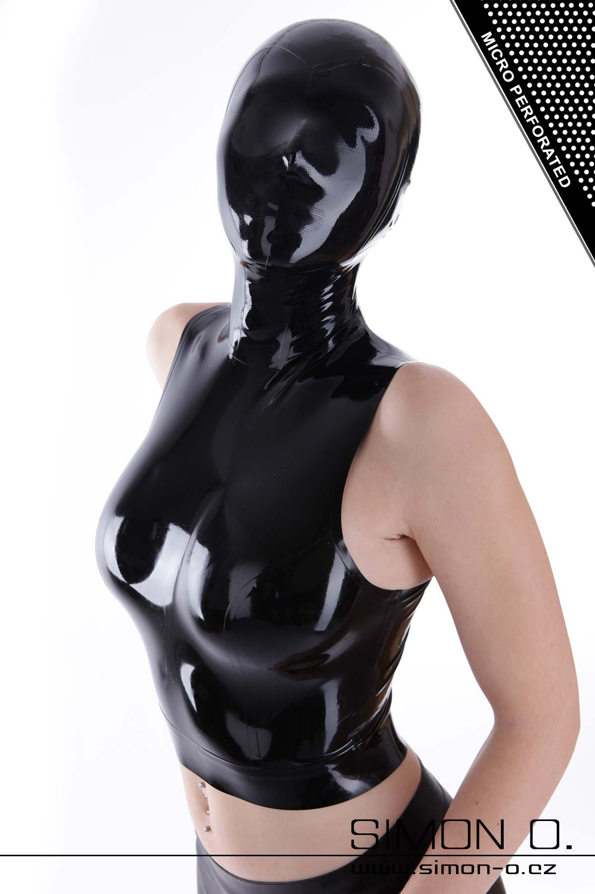 A woman wears a latex top with a latex hood in black. The hood has many small holes in the eyes and mouth.