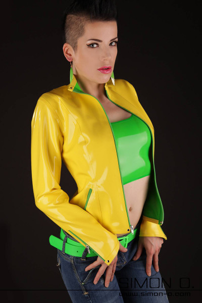 A woman in a yellow latex jacket. She wears a latex top underneath.
