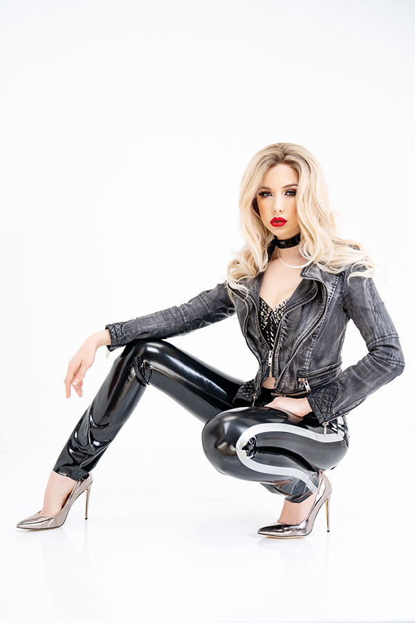 Skin tight shiny ladies latex jeans in black with side stripes