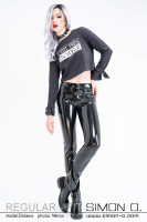 Preview: A woman wears a black latex jeans in combination with a shirt